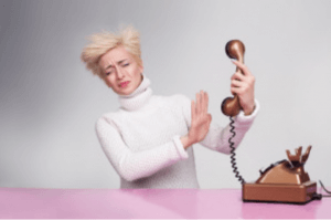 woman dealing with verbal abuse over the phone